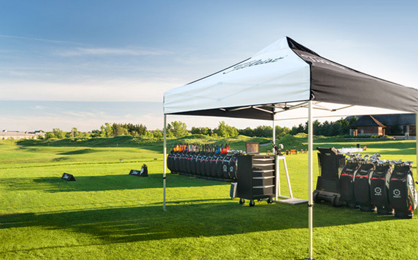 Titleist clubs under a tent
